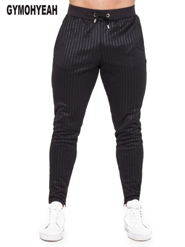 d557b88c50c GYMOHYEAH осенние мужские спортивные брюки классические полосатые мужские  брюки повседневные Модные дышащие стильные брюки высокие уличные