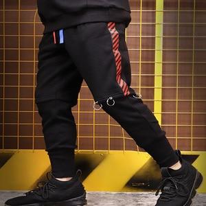Image 5 - Mens נשים בתוספת קטיפה זוג מכנסיים מטען מכנסיים כיסים גדול גודל רצים ספורט זכר מכנסיים מכנסיים Ninja טרנינג S 3XL