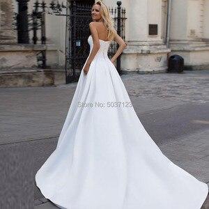Image 2 - Saten A Line Gelinlik 2019 Boncuk Backless gelinlikler Mahkemesi Tren Straplez Vestidos de Noivas Beyaz Custom Made