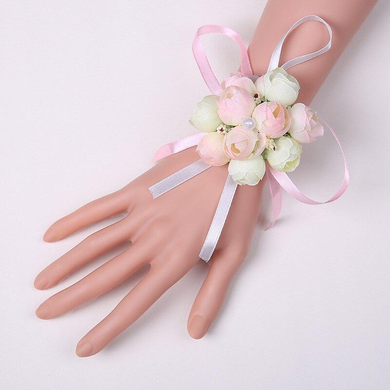 e4326f8dfead5 100 pcs Noiva Mão Da Flor de Dama de honra de Pulso Flores Artificiais de  Seda Rosa Artificial Flores Decoração Do Casamento 4 Cores WA1936