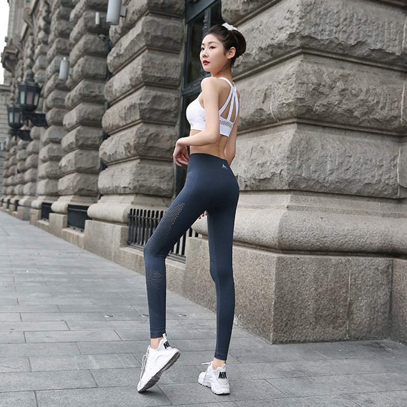 2018 New high waist elastic quick-drying personality sports yoga Sexy side hollow hip fitness running pants