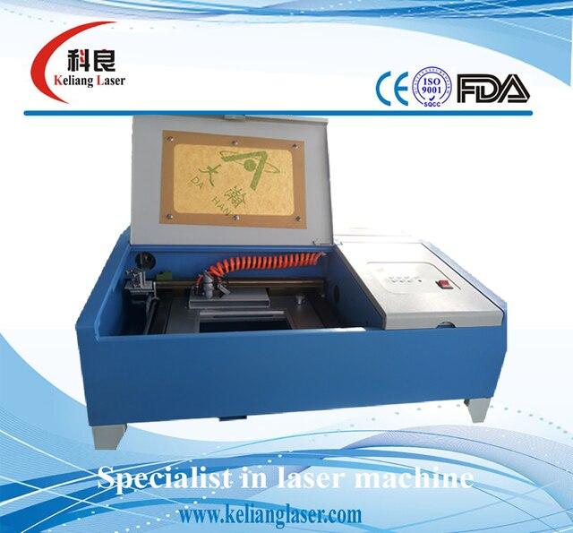 China Cheap 40w Co2 Mini Laser Engraving Machine Rubber Stamp Making Price