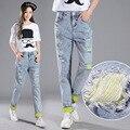 Calle de la moda desgaste roto agujero alta cintura femenina pantalones harem denim elegante del doblez diseño tobillo-longitud abertura de la pierna jeans mujeres