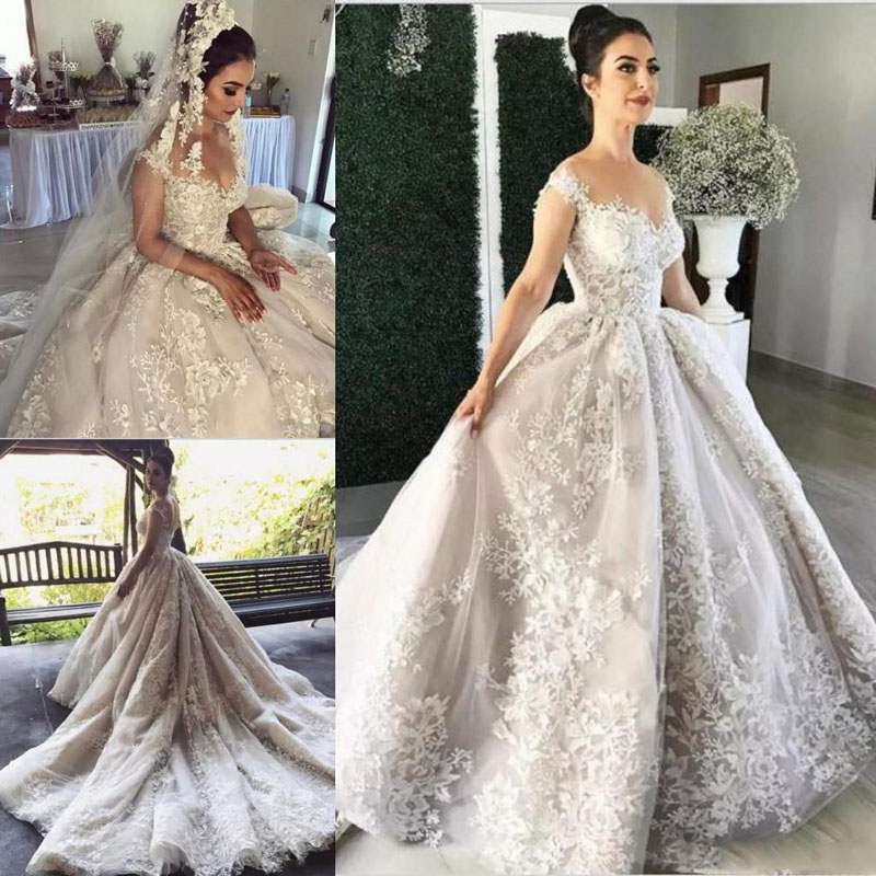2018 Gorgeous White Wedding Gowns Puffy Chapel Train Lace
