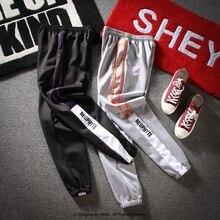 8de960b2e0310 Pista Sportwear pantalones rayados laterales doble Retro chándal hombres  Hip Hop Streetwear urbana escuela estilo Joggers
