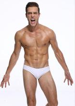 Free shipping Mens low-waisted white swim trunks tight swimsuits fast drying sexy Super elastic
