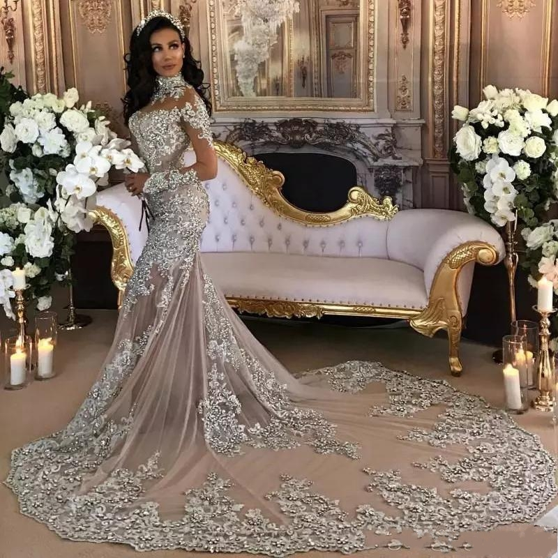 Dubai Arabic Luxury 2019 Wedding Dresses Sexy Bling Beaded Lace Applique High Neck Illusion Long Sleeves Mermaid Bridal Gowns