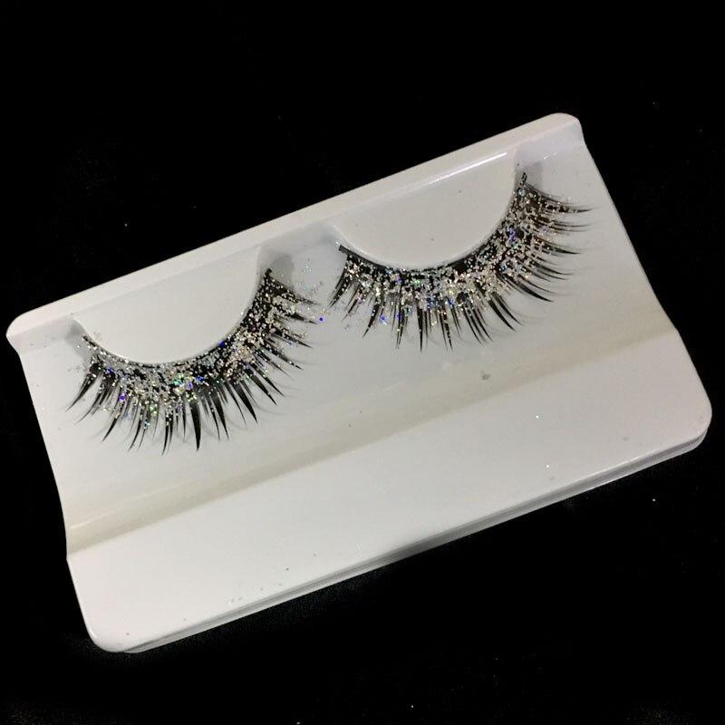 a pair of loaded nightclub makeup exaggerated fashion glitter, fake eyelashes false eyelashes