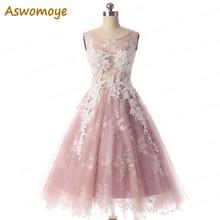 Aswomoye elegantes kurzes Abendkleid 2018 neues stilvolles Illusion Oansatz rosafarbenes Abschlussball-Kleid Sleeveless robe de soiree