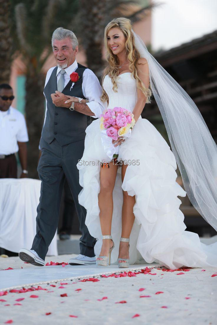 whitney port wedding dress high low wedding dress Jim Hjelm sheer A line wedding with netting and 3 D flower details from