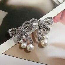 Mimiyagu trendy luxury bowknot cubic pearl stud earring for women party gift earring jewelry