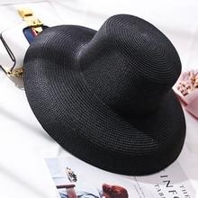 Nuevo 2019 blanco y negro tejido hecho a mano vendido sombreros de Sol para  las mujeres grandes ala del sombrero de paja playa a. 9b3f4f9b55c