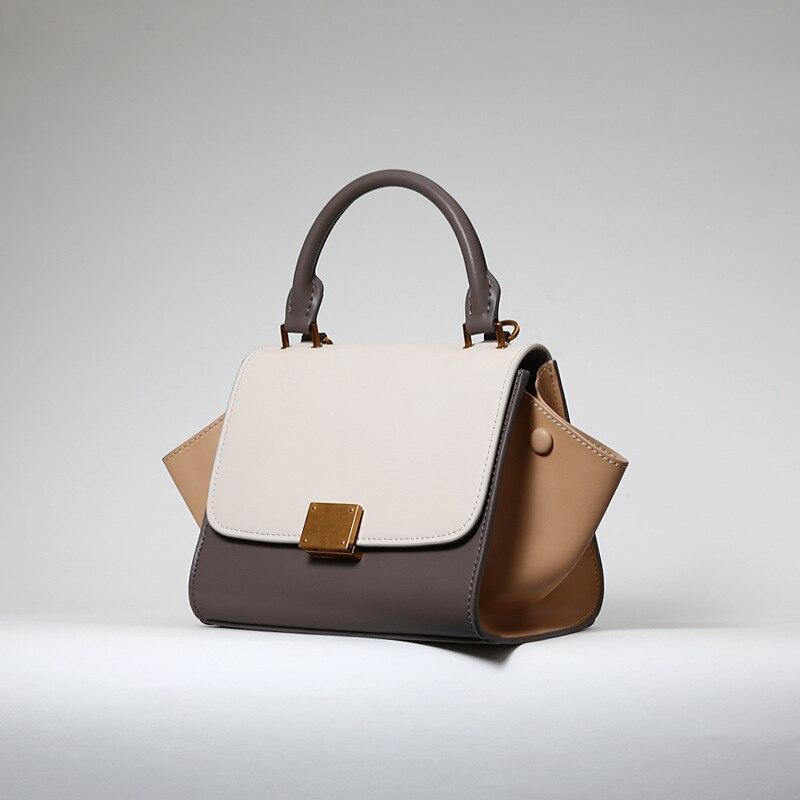 Marque de mode rétractable poignées sacs à main de luxe femmes sacs designer simple contraste couleur bat ailes en forme de femmes sac