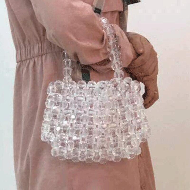 Sac en cristal perlé net rouge avec la main mobile fée creux sacs transparents femmes marques célèbres sacs à main de luxe femmes sacs