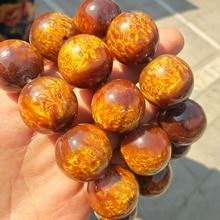 Golden willow coral bulb specimen hand string healing