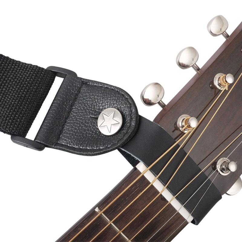 Valódi bőr gitár heveder gomb tartó akusztikushoz, erős fém rögzítővel, a nyak fölé illeszkedik a 8-as fejlécre