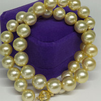 My dear natural pearl necklace is 10 12mm south China sea gold pearl jewelry, round, high gloss, elegant,
