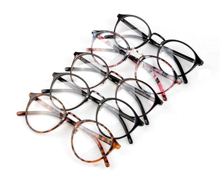 NUEVO 2019 Mujeres Retro anteojos ópticos Moda Ronda Marcos de vidrio liso Gafas de lectura Oculos de grau feminino metal Rivet N97