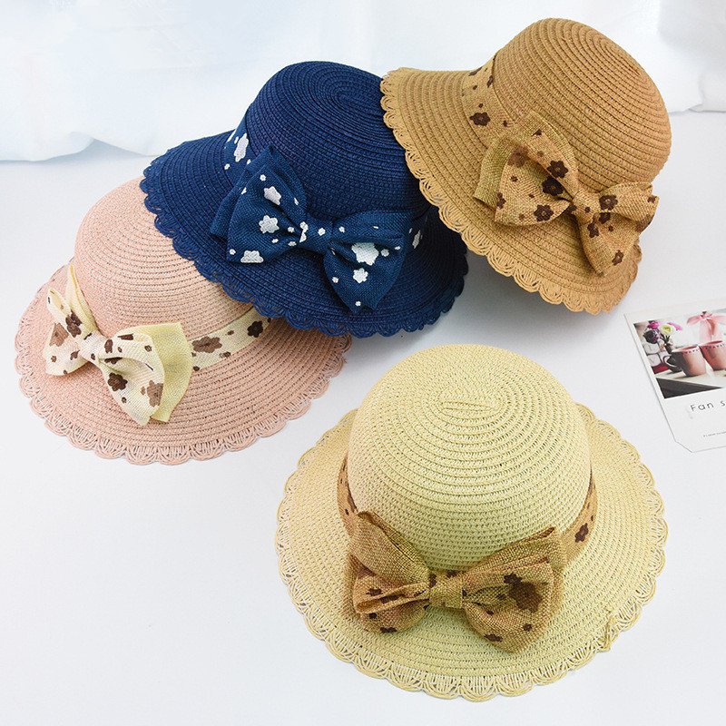 Baby hats Korean childrens summer parent-child straw hat big along visor princess girl cute bow beach hat UV protection capsBaby hats Korean childrens summer parent-child straw hat big along visor princess girl cute bow beach hat UV protection caps