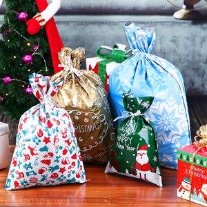 Image 5 - 30pcs Regalo Di Natale Borse Carino Coulisse Assortiti Stili Goody Borse Da Imballaggio del Regalo Bomboniere E Ricordini Per Le Vacanze Di Natale Sacchetto Della Caramella
