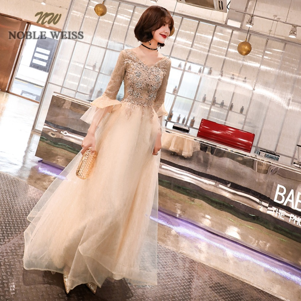 prom     dresses   v-neck champagne tulle a-line   prom     dress   sexy see through back appliques beading long   prom     dresses   with sleeves