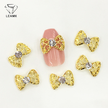 LEAMX 10Pcs/bag Hollow-out Bow Glitter Nail Art Decoration Rhinestone Tie Alloy 3D DIY Tools For Manicure Decor L463