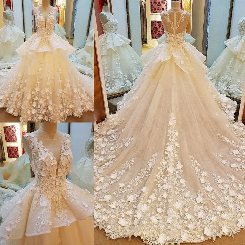 1431 99 5 De Reduction Robes De Mariee De Luxe 2018 Perles Cristal Robe De Bal Fleurs Longue Queue Robes De Mariee Vraies Photos In Robes De Mariee