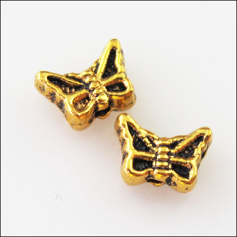 35 New Charms Tiny Animal Wings Spacer Beads 5.5x16mm Antiqued Bronze