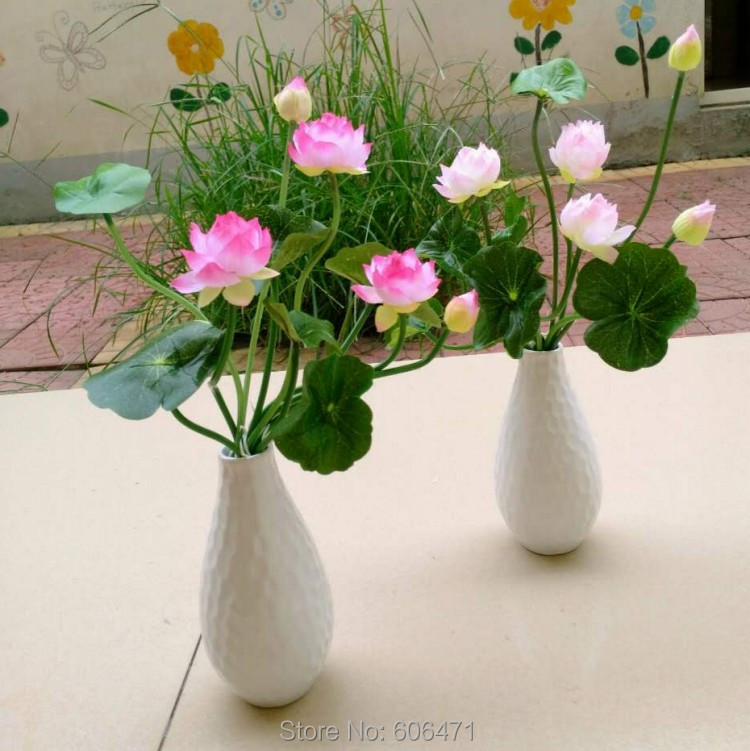 Lotus with vase flower arrangement centerpiece free