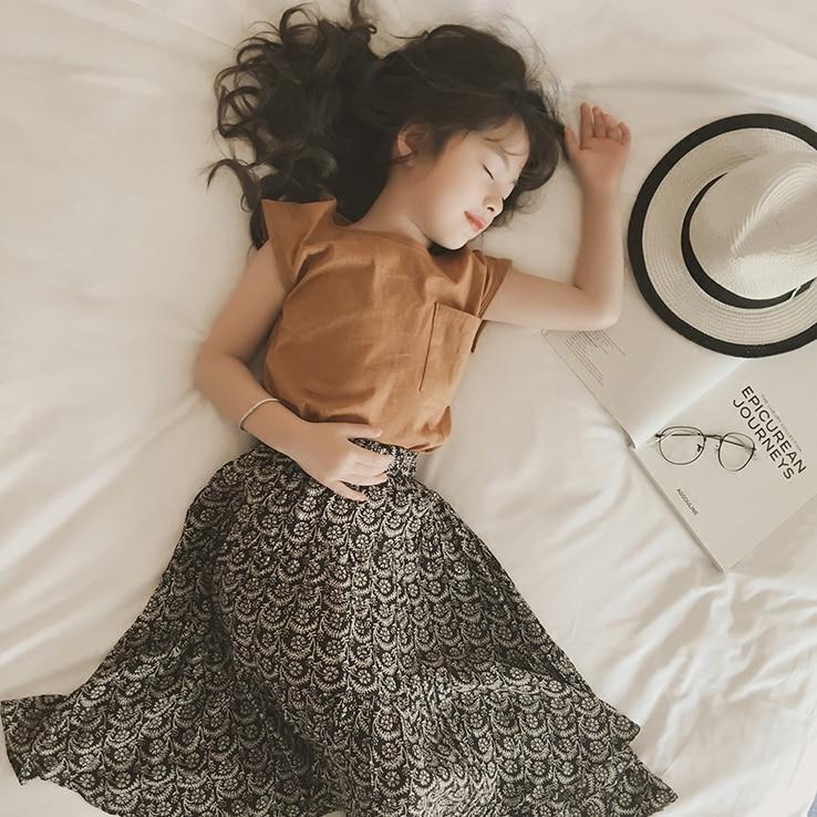 dfd8c31a3 Nuevo 2019 niños dos piezas conjunto marca bebé niñas verano Floral  conjunto camisa y falda niños ropa de manga corta para niñas conjunto de ...