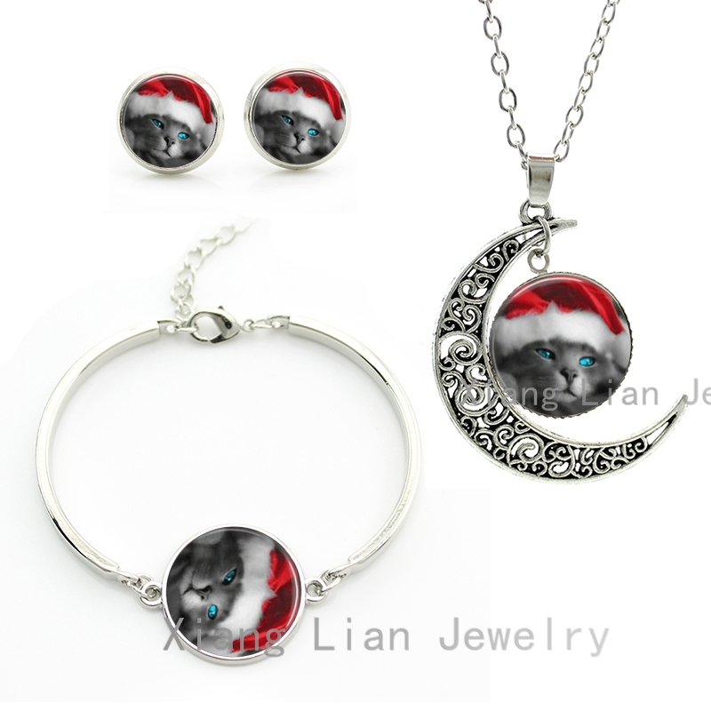 Cute blue eyes cat wearing red christmas hat necklace for Cat in the hat jewelry