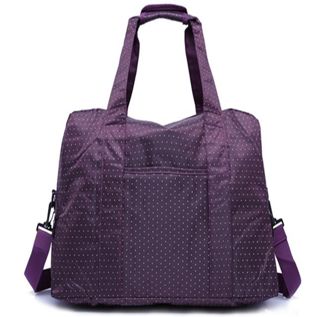 Mulheres roxo saco de viagem bagagem Nylon impermeável bolsa grande capacidade de um ombro com forte lidar com mala de viagem
