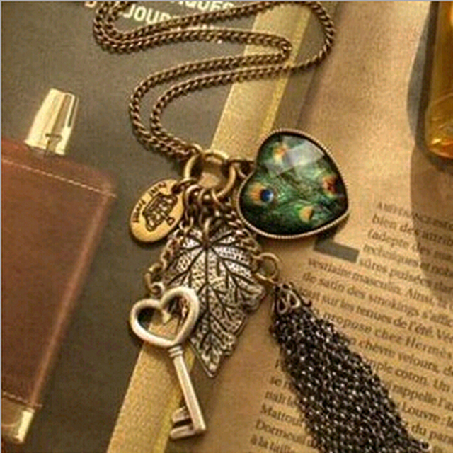 FAMSHIN high quality retro peacock feather necklace fashion  leaves peach heart  tassel personality sweater chain necklace