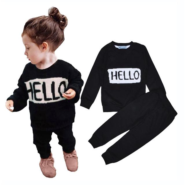 Muchacha de la ropa de los bebés fijó deportes hola adiós camiseta + pantalón negro sistemas de la ropa para la niña de otoño 2016 del deporte del bebé que arropan el sistema