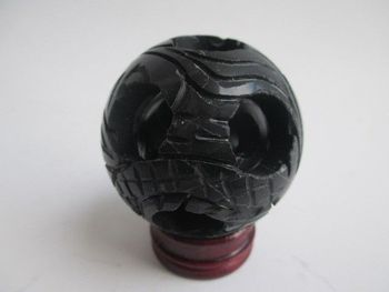 Chinese jade hand carved empty dragon ball.