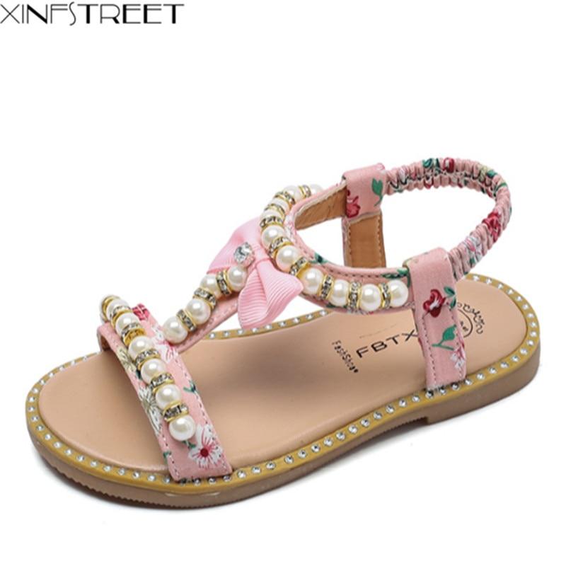 6099fd6e6d1f36 Xinfstreet-Baby-Girls-Sandals-Kids-Summer-Shoes-T-Strap-Pearls-Cute -Bow-Toddler-Children-Princess-Sandals.jpg