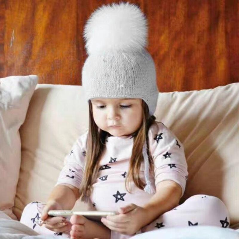 a3211659b242 Solid Color Baby Winter Warm Hat with Big Fur Ball Decor Fashion ...