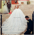 New Romantic Ball Gown Princess Wedding Dresses 2017 Sheer Elegant Long Illusion Sleeves Spring High Quality Modern Stunning
