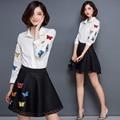 2016 nuevas mujeres del verano Mini juegos de falda 2 unidades Set mujeres blanco de manga larga camisa de gasa bordado y negro ahueca hacia fuera las faldas