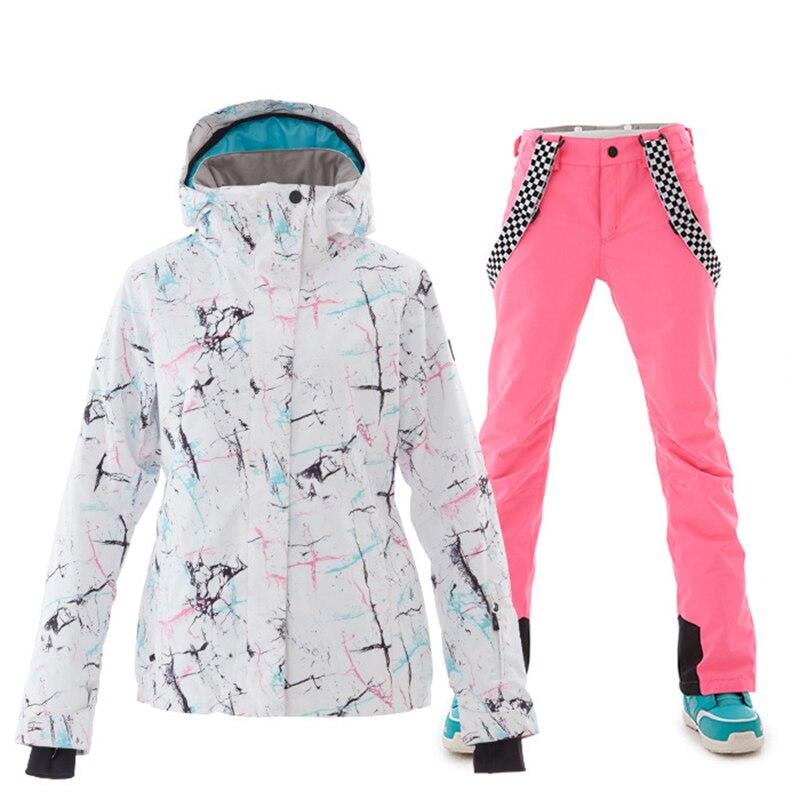 Marques combinaison de Ski femmes de haute qualité femme coupe-vent imperméable hiver ensembles veste de neige et pantalon Ski et snowboard costumes