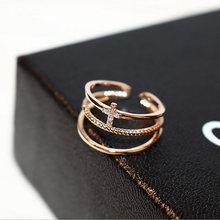 Женское многослойное кольцо с фианитом золотистое металлическое
