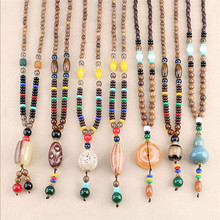 все цены на Retro Ethnic Nepalese Lotus Horns Prayer Wheel Pendant Necklaces for Women Chicken Wing Wooden Beads Sweater Chain Gifts онлайн