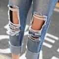 Moda Jeans de perna de comprimento calças Jeans mulheres Harem calças soltas buracos Jeans rasgado rasgado Sexy S-XL B6518