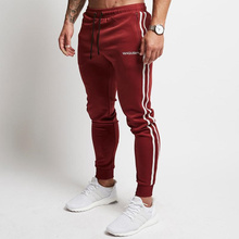 Joggings pantalones alta cintura Jogger gimnasios pista pantalones hombres  algodón Bodybuilding ropa deportiva elástica Hombre Pantalones 7fe0624e8ba