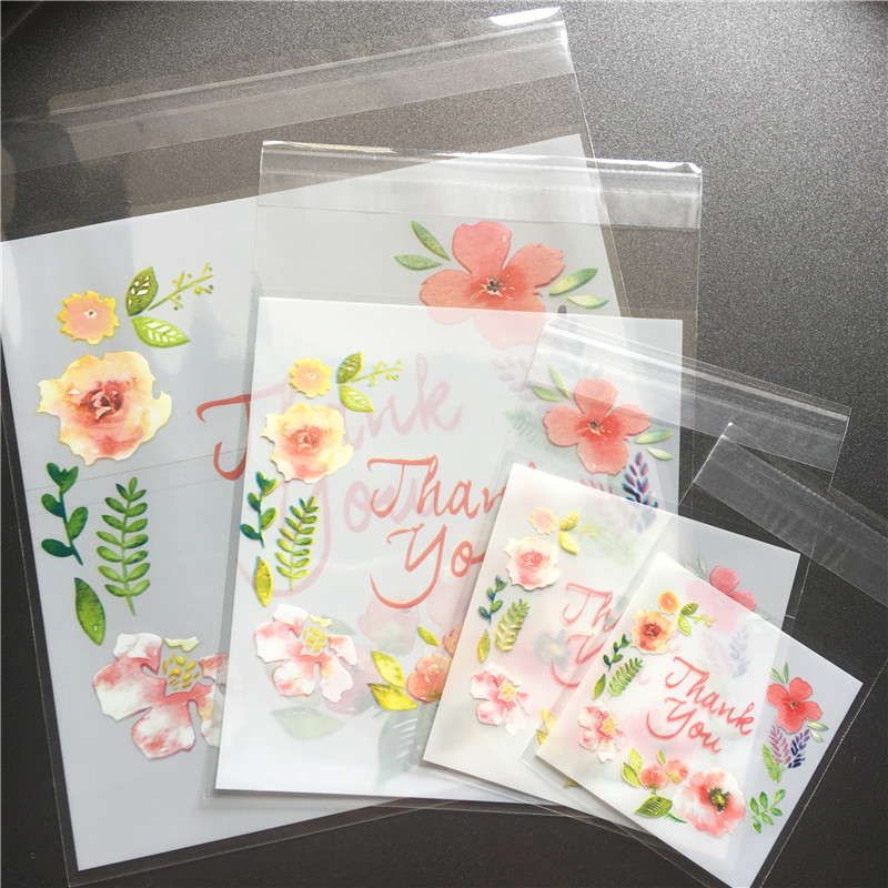 100pcs Self-Adhesive Plastic Thank You Flower Cookie Package Candy Floral Bag UK