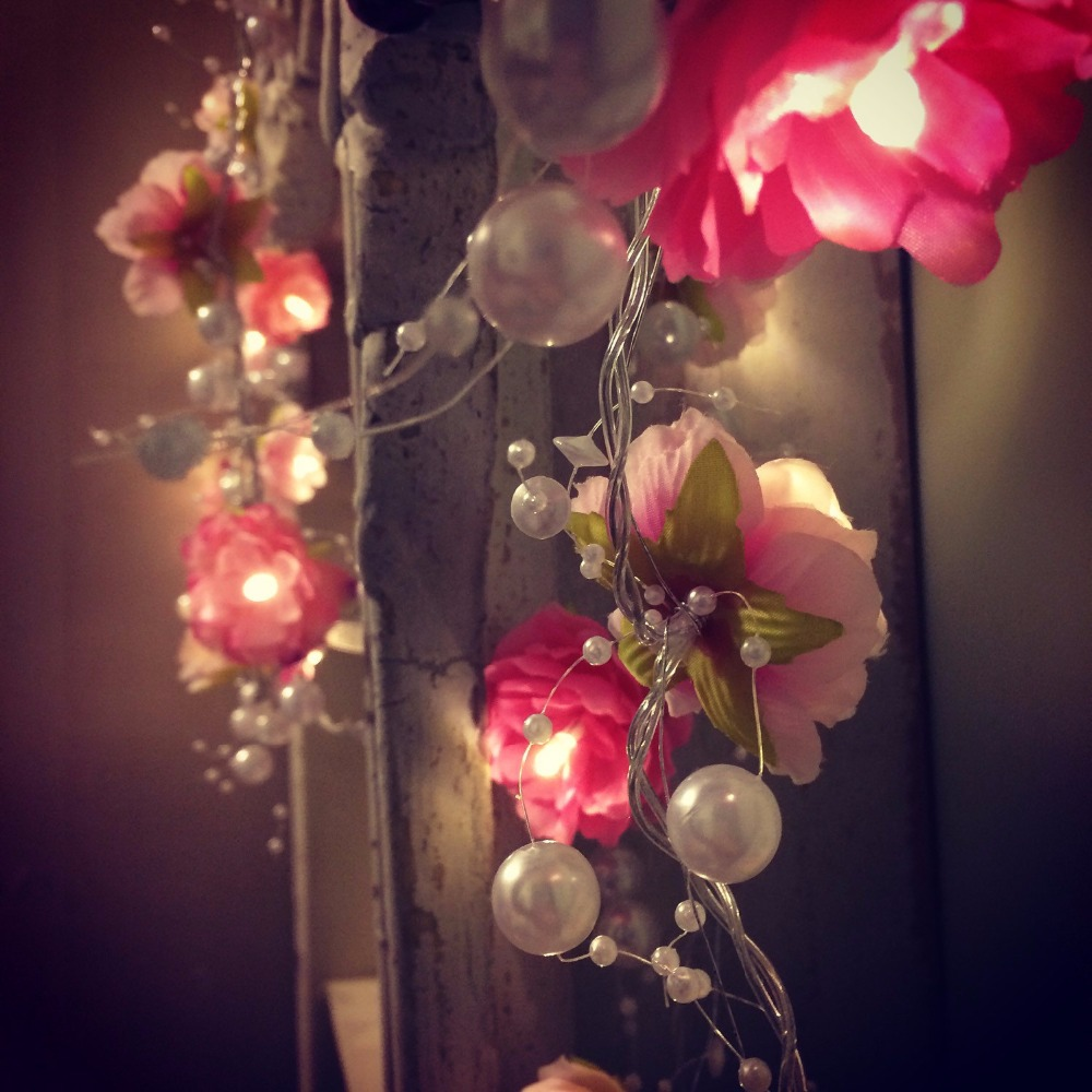 Creamy white pink rose flower garland fairy lights with - Decorating with string lights indoors ...