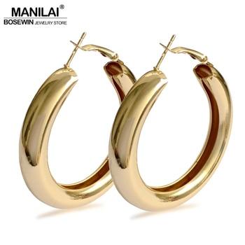 Boucles d'oreille 50mm diamètre alliage Boucles d'oreilles Bella Risse https://bellarissecoiffure.ch