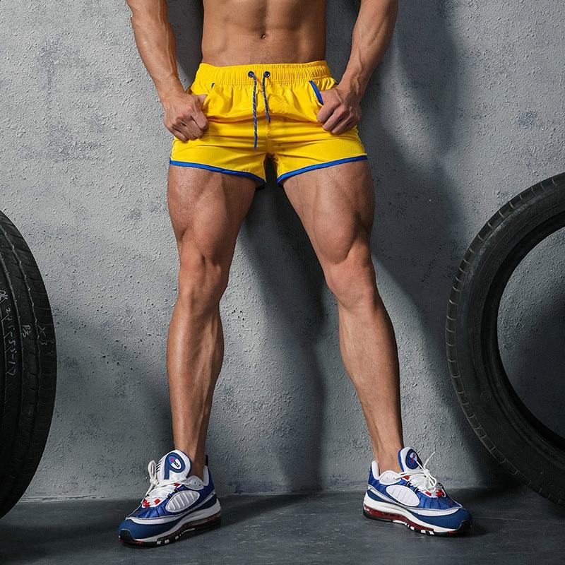 Brand Men Shorts Loose Fashion Short Trousers Casual Calf-Length Jogger Mens Shorts Sweatpants Fitness Man Workout Cotton Shorts