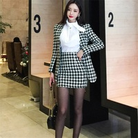 Women's autumn and winter new fashion temperament houndstooth wool coat + bag hip mini skirt suit AL646