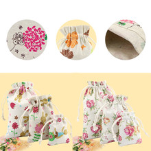 Hot 1PC Flowers printed Burlap Christmas Gift Bags Wedding Favor Drawstring Pouch Useful Jewelry Storage bag(China)